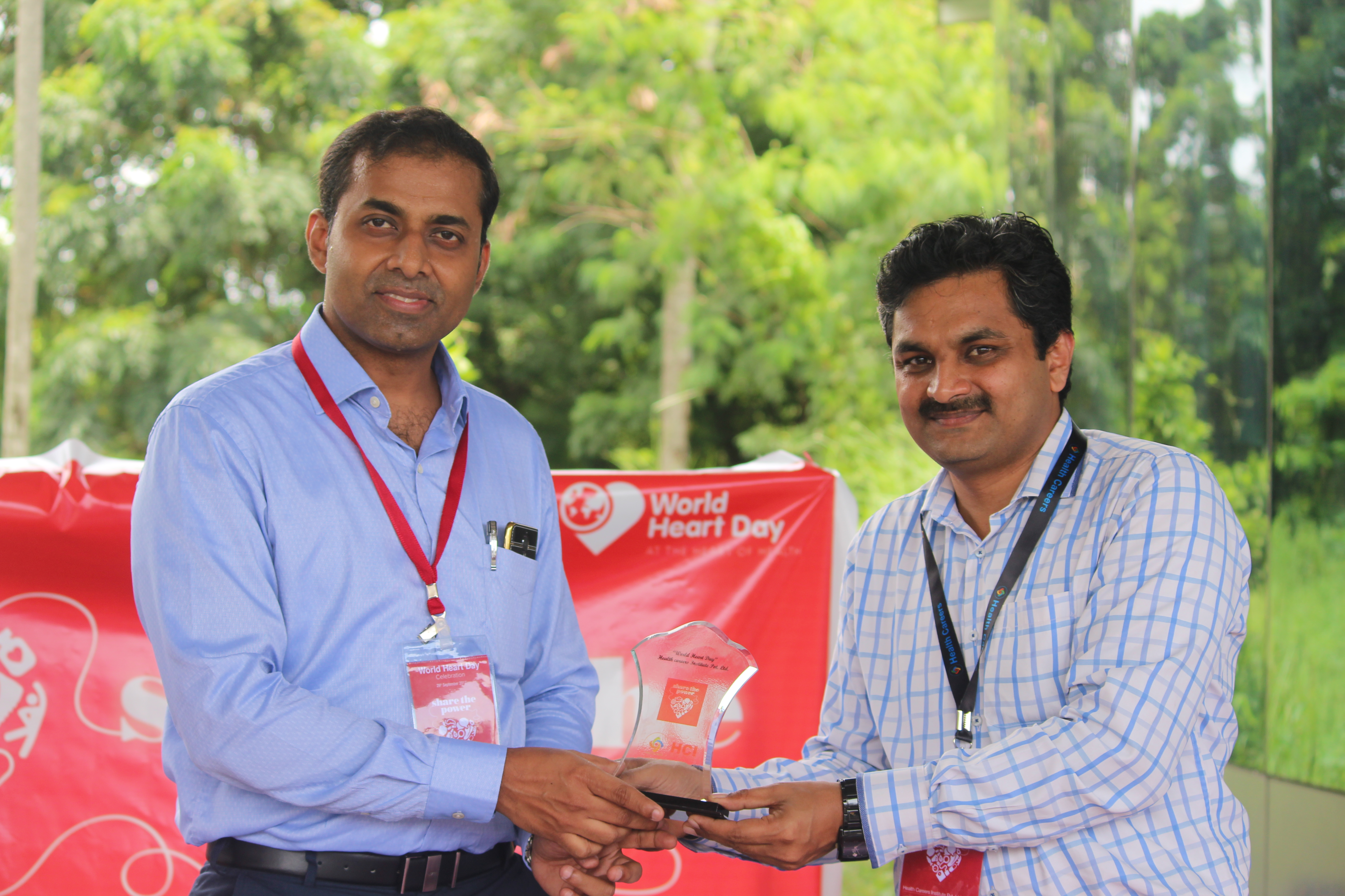 giving momento by principal Mr.Jeril Cherian
